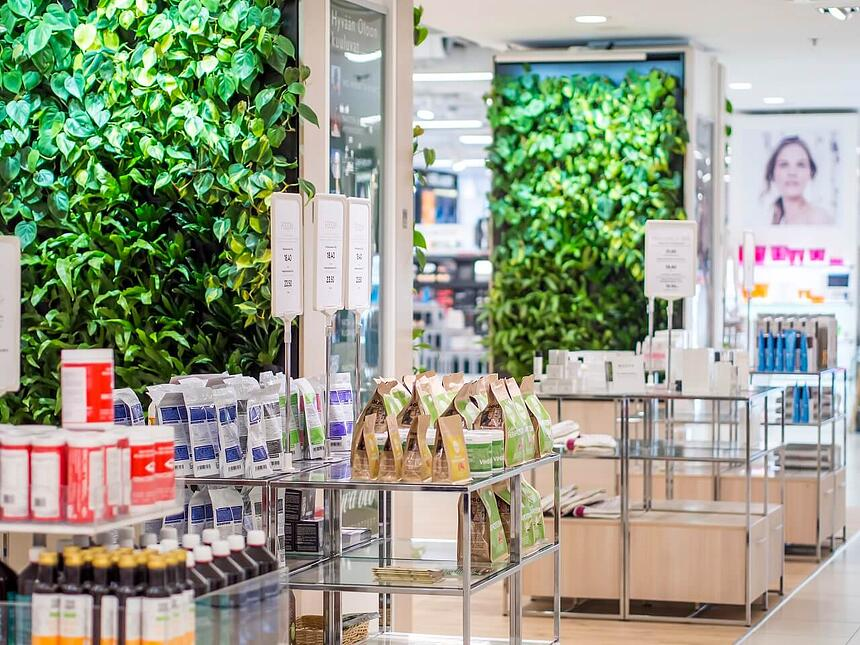 The green walls enhance the store's natural feel.