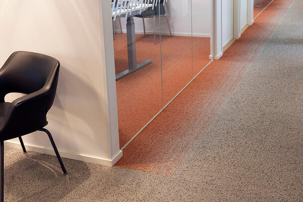 The gradient colored carpet creates an optical illusion.